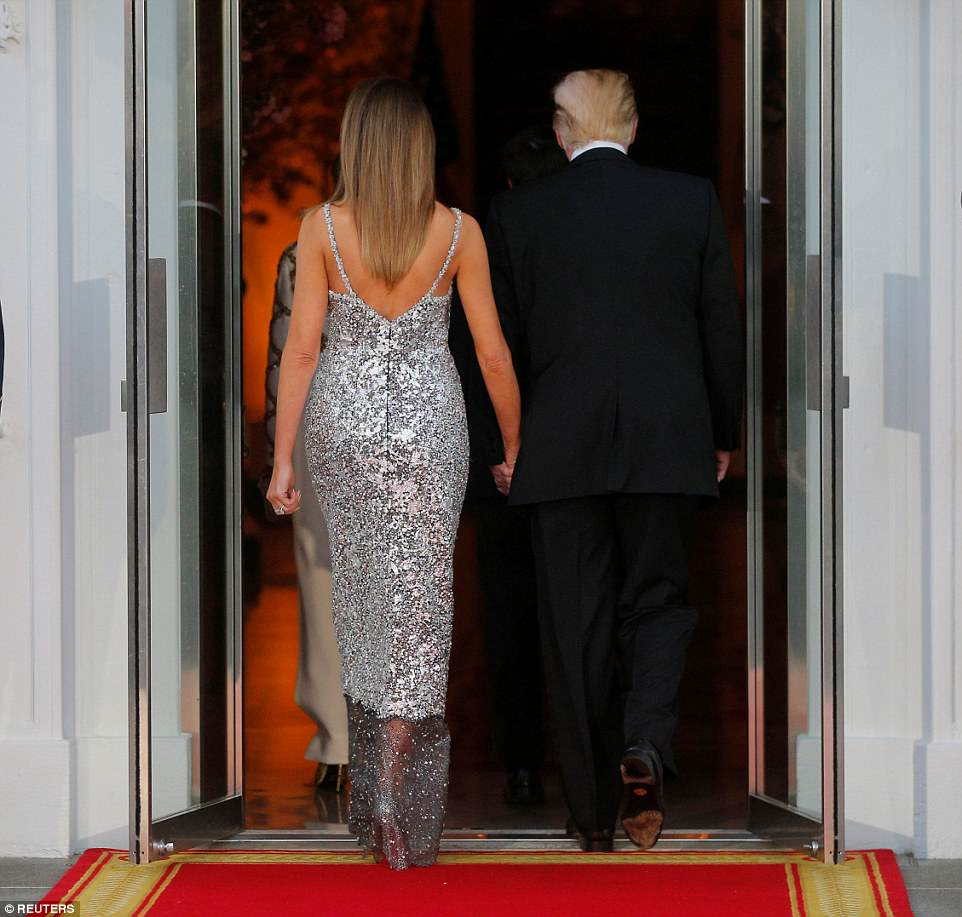 All eyes were on Melania as she stole the show in a Chanel black Chantilly lace haute couture gown that had been hand-painted with silver and embroidered with crystal and sequins