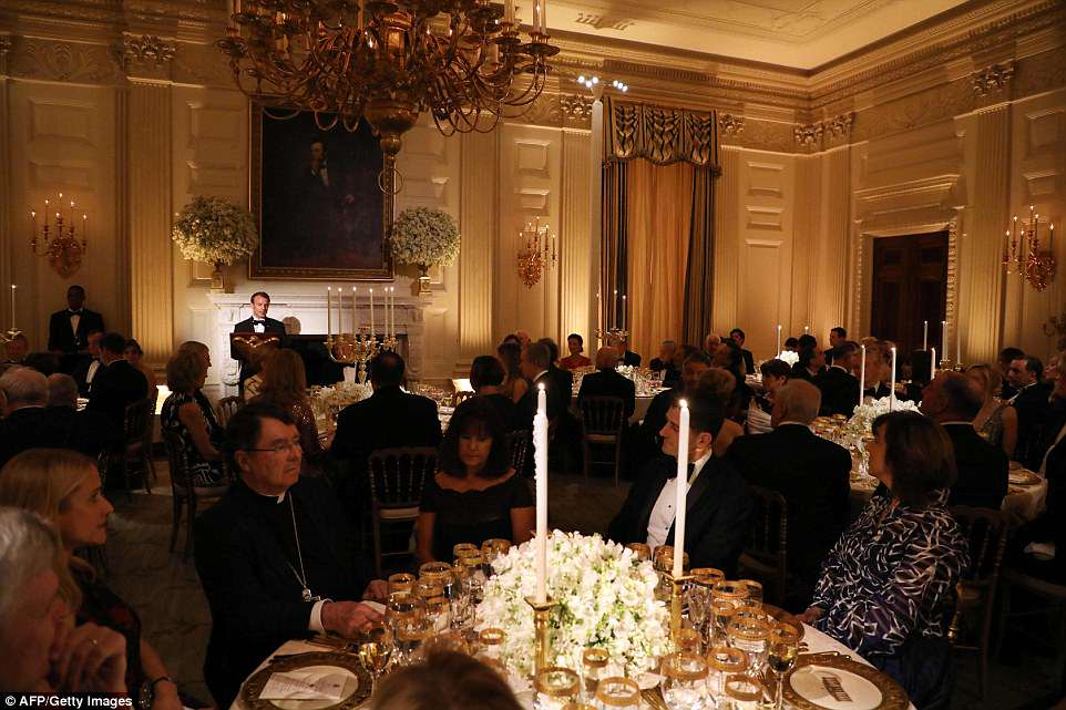 French President Emmanuel Macron speaks during a state dinner in his honor at the White House