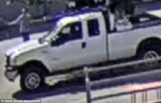 The white Ford truck cops say Juarez used to drive away from the Home Depot in Dallas following the incident. It is seen here in surveillance camera footage released by Dallas PD
