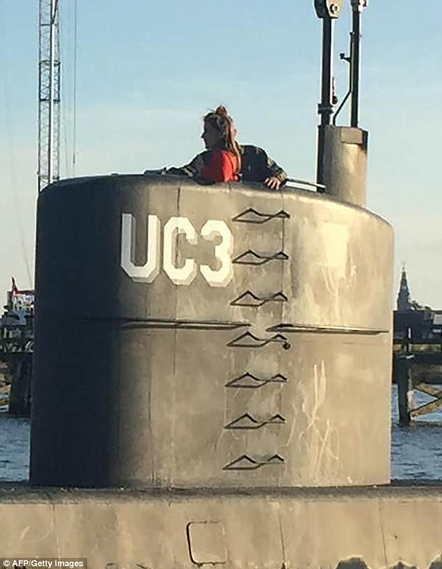 One of the last photos taken of Miss Wall shows her standing in the tower of the private submarine with Madsen on August 10