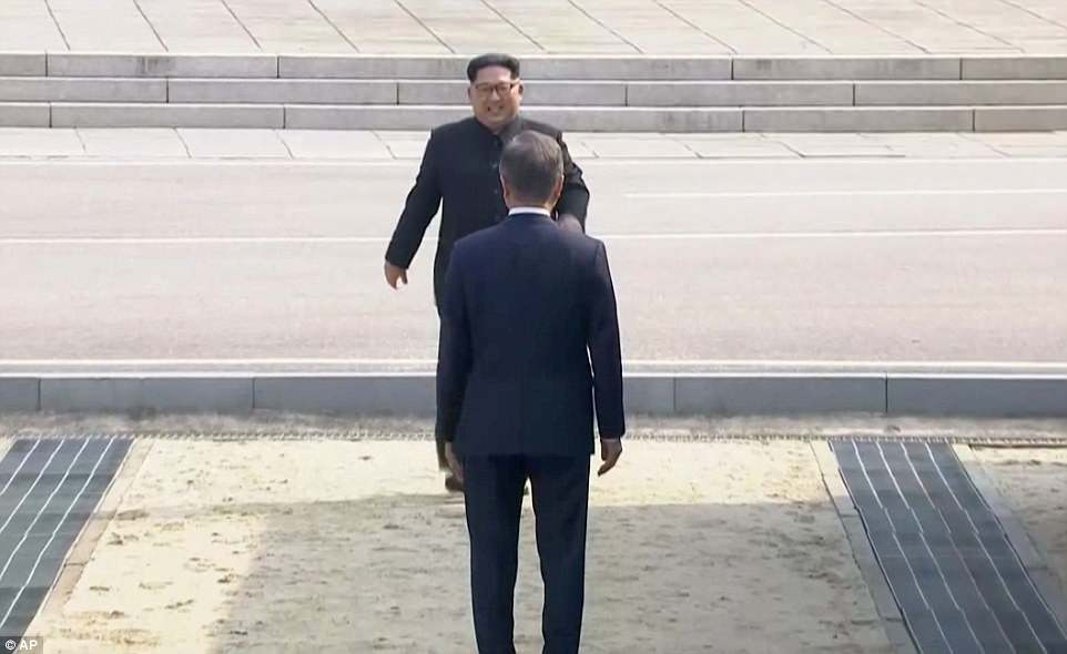 A smiling Kim emerges right on cue from a large building on the northern side of the border, walked down a wide flight of stairs and strolled confidently toward Moon to begin the historic meeting