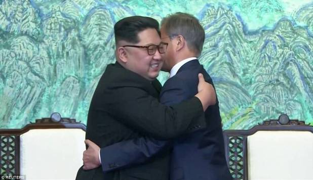 Kim Jong-un and his South Korean counterpart Moon Jae-in have embraced warmly after signing a statement in which they declared 'there will be no more war on the Korean Peninsula'