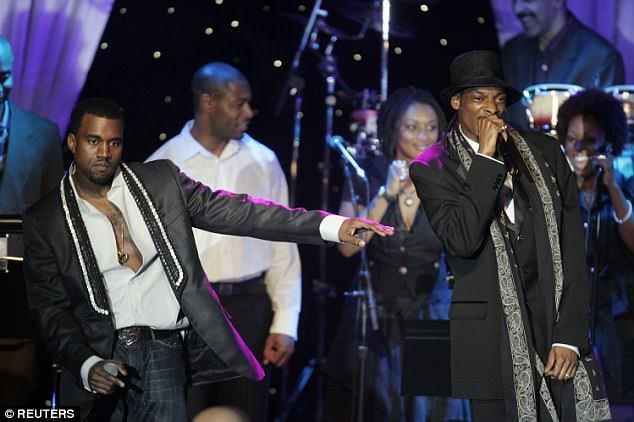 Working relationship: Kanye and Snoop perform at the Clive Davis pre-Grammy dinner party and show in Beverly Hills, California February 7, 2006