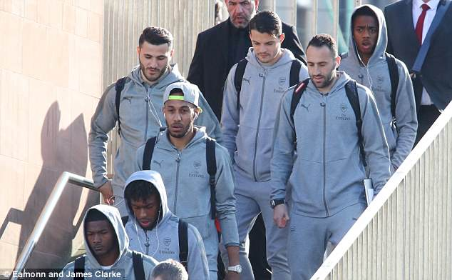 Arsenal players arrive in Manchester after travelling by train ahead of Man United match