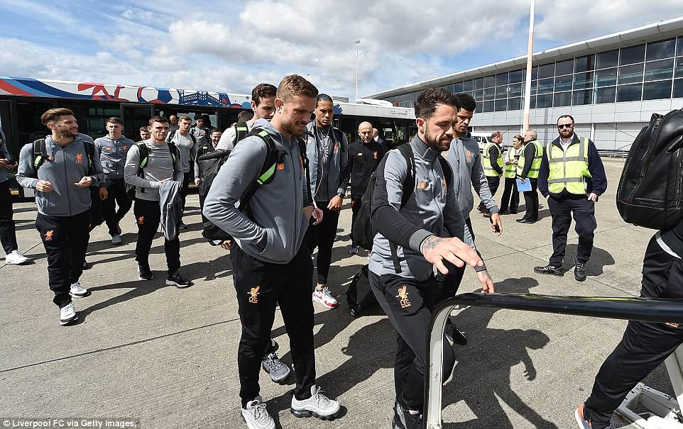 Henderson and Danny Ings of Liverpool boarding the plane at Liverpool John Lennon Airport ahead of their journey