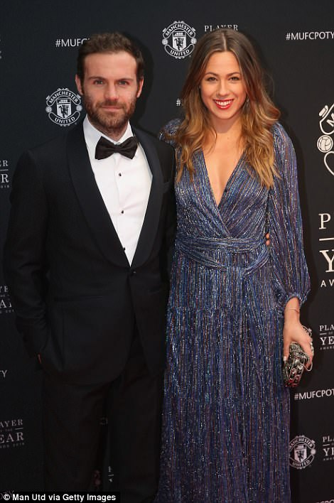 Fellow Spaniard Juan Mata stood with wife Evelina Kamph