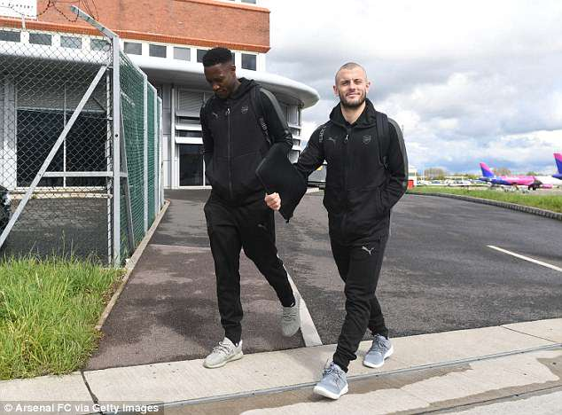 Arsenal duo Danny Welbeck (left) and Jack Wilshere make their way towards their team plane