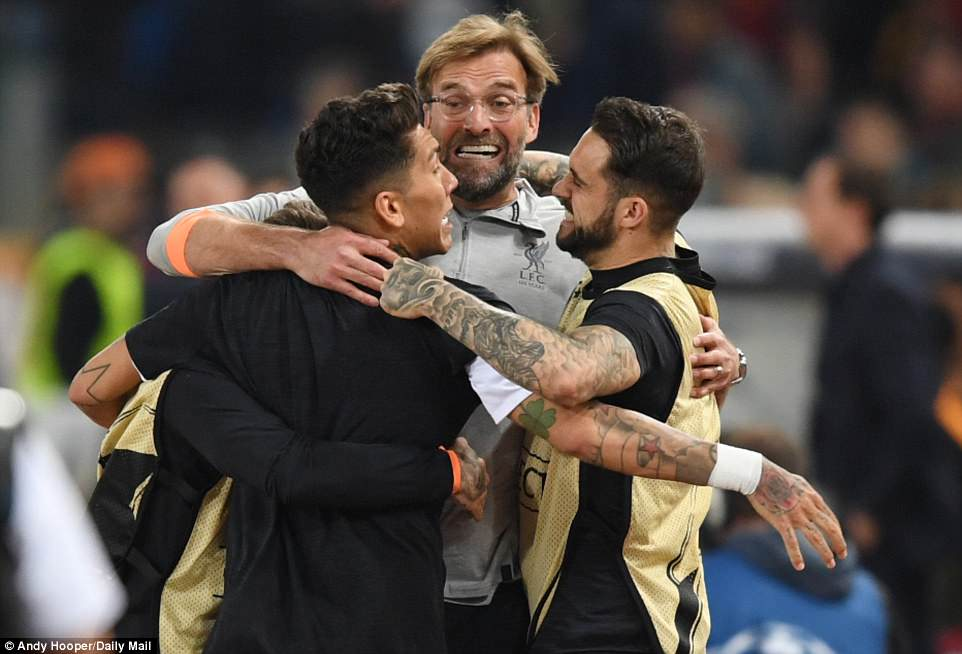 Liverpool manager Jurgen Klopp embraces his players on the final whistle after they edge past Roma on Wednesday