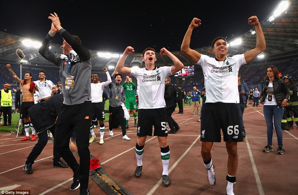 Trent Alexander-Arnold (right) and Ben Woodburn of Liverpool celebrates after the full time whistle with the travelling fans