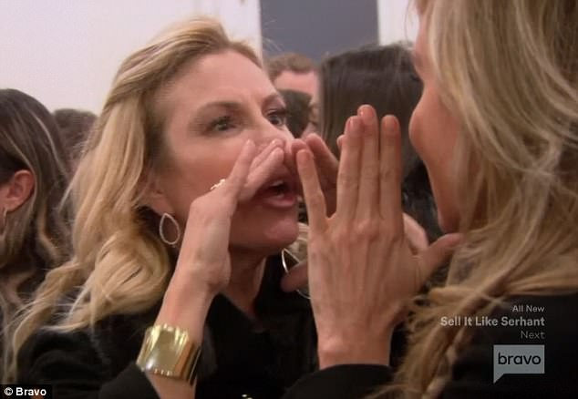 Face to face: The reality stars put their hands next to their mouths as they yelled at each other