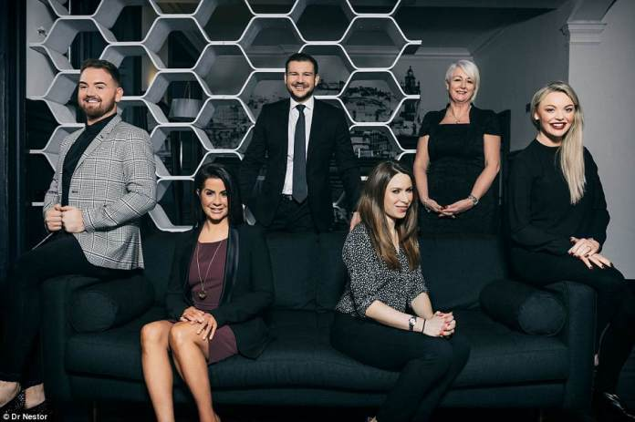 The dream team: Dr Nestor's'super clinic' offers an abundance of services from aesthetic medicine to hair restoration, female intimate health and GP services, in an ultra-chic city centre setting (Dr Nestor is pictured centre with experts at the clinic)
