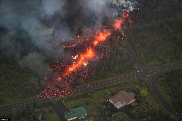 A 2,000 foot long fissure erupts within the Leilani Estates subdivision, on the east rift zone of the Kilauea volcano on Saturday