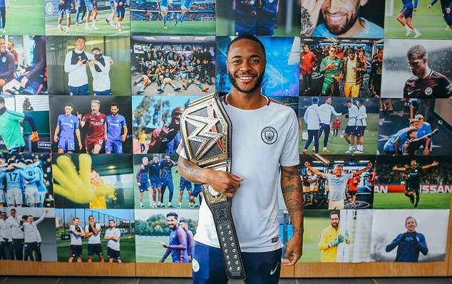 England forward Raheem Sterling had a big grin on his face as he carried around the title belt