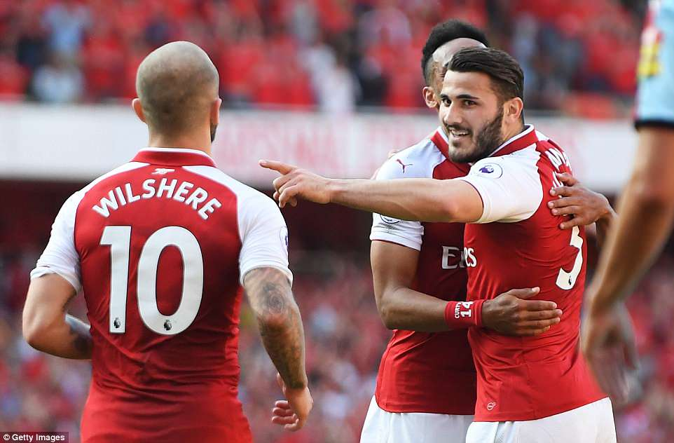 Kolasinac (right) celebrates Jack Wilshere (left) and Aubameyang after bagging his fifth goal of the season