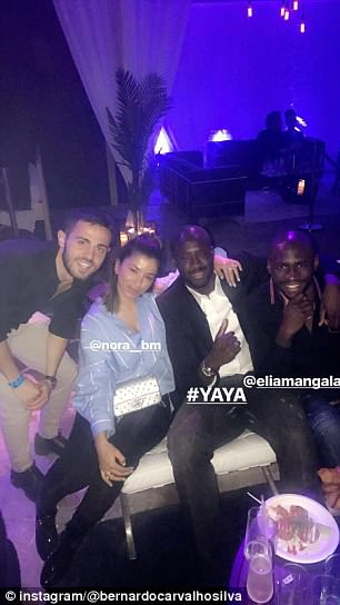 Bernardo Silva, Yaya Toure and Eliaquim Mangala (left to right) posed for a snap as they toasted their club's title victory on Sunday evening