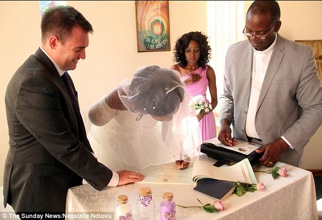 Incredible strength: Determined to still have her wedding day as planned, the couple wed in the hospital chapel with now Mrs Fox still bandaged up