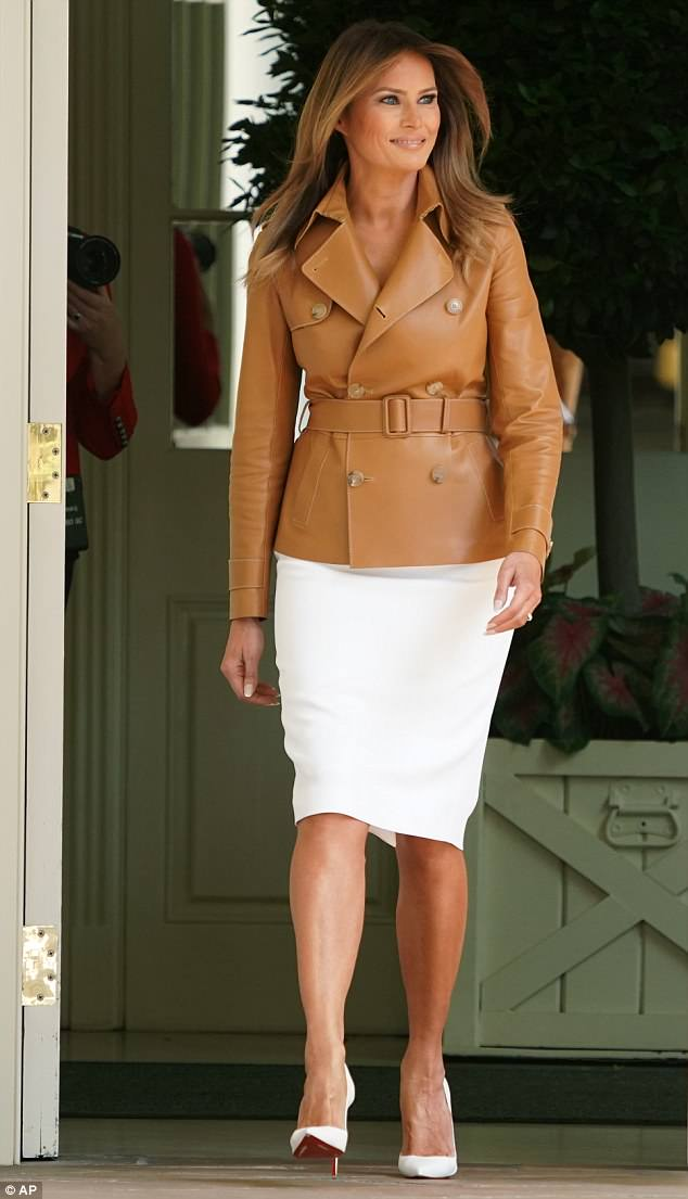 The first lady wore a $5,990 Ralph Lauren trench jacket despite the soaring temperatures in Washington, D.C.