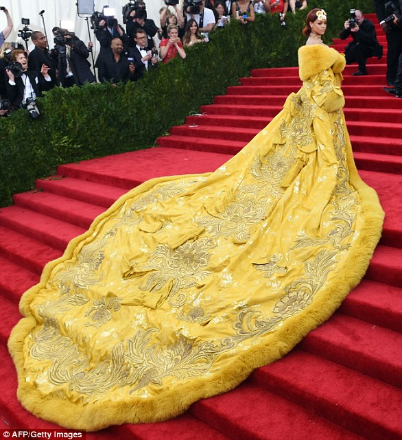 The dress to end all dresses: Rihanna made Met Gala history in 2015 at the exhibition which explored 'the impact of Chinese design on Western fashion' when she tore the famous stairs in the iconic vast yellow coat dress designed by Chinese designer Guo Pei