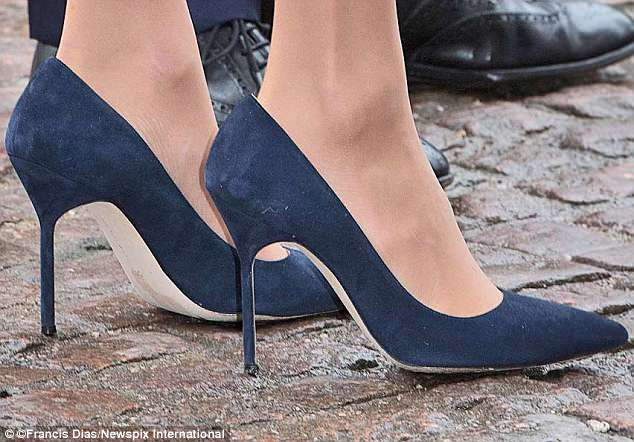 On parade: Nylon tights and elegant blue suede Manolo Blahnik BB pumps for the Commonwealth Service in March this year