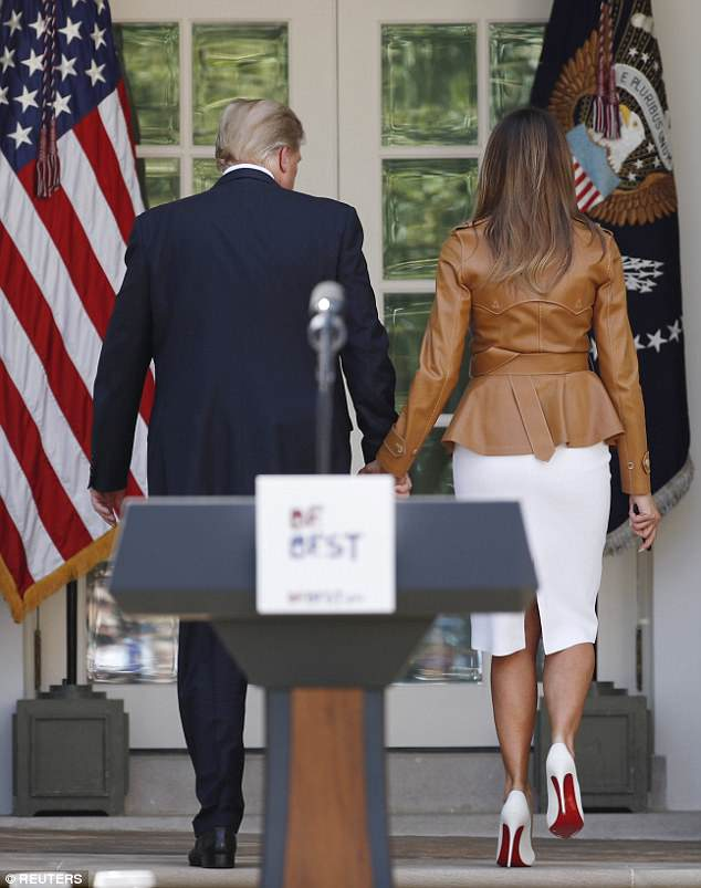 Melania and her husband held hands as they left the Rose Garden together