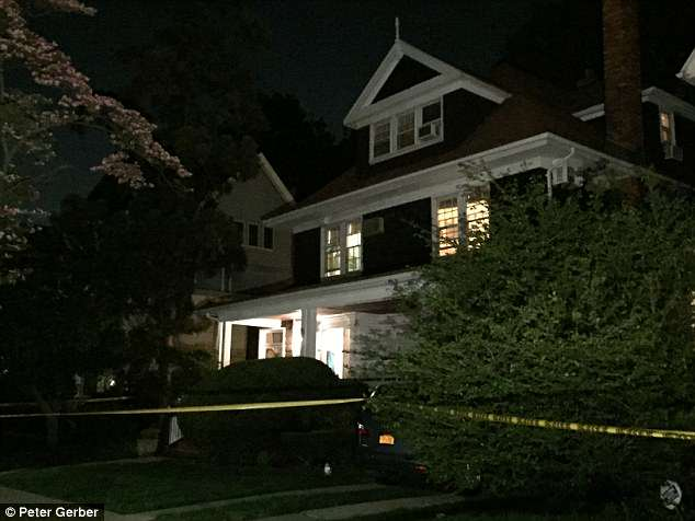 Police found his body at his Brooklyn home (pictured) moments before they discovered a blood-soaked man hiding in a closet