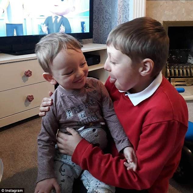 Pictures show Leo laughing at home with his brother Oliver, nine
