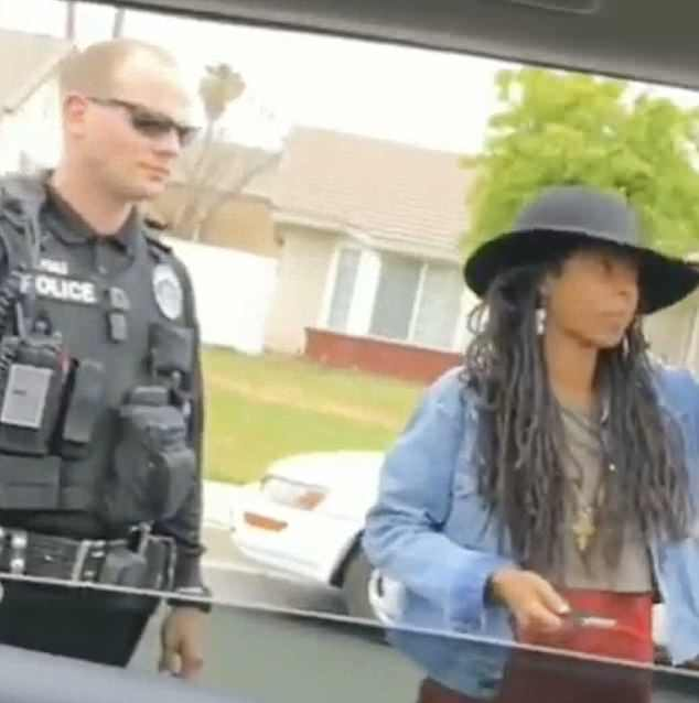 The trio - which also included Kells Fyffe Marshall and Komi-Oluwa Olafimihan - were released when the officers established they were indeed Airbnb guests. Pictured: Prendergast and an officer