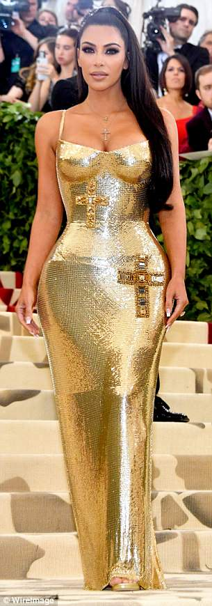 Poking fun: Kim Kardashian was also teased over her gold dress, with one Twitter user comparing it to a golden Chalice