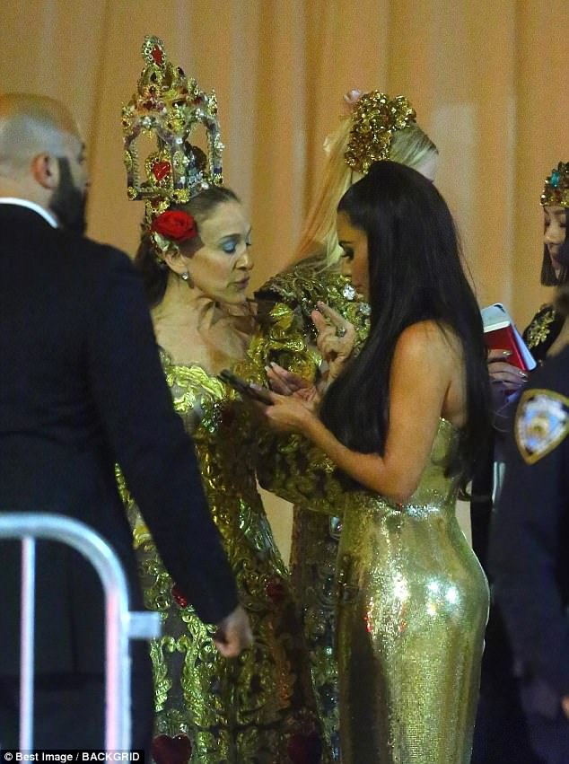 Girls' night: Kim seemed to be swapping phone numbers with Sarah Jessica Parker as she they headed home after the event