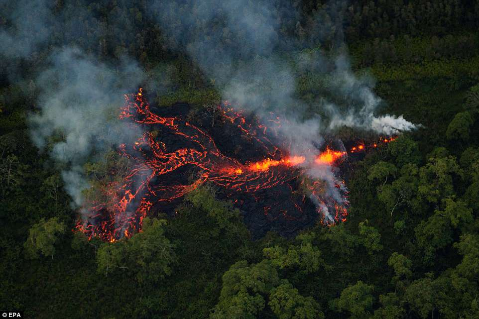 Volcanic activity continues, as a new fissure erupts in a field roughly 1/2 mile east of the Puna Geothermal Venture facility, Hawaii on Saturday
