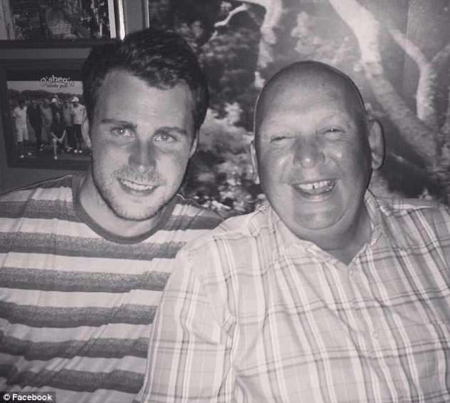 Neil Whitfield (pictured right with his son) is suing Nokia over claims sustained mobile phone usage resulted in a brain tumour that has left him deaf in one ear