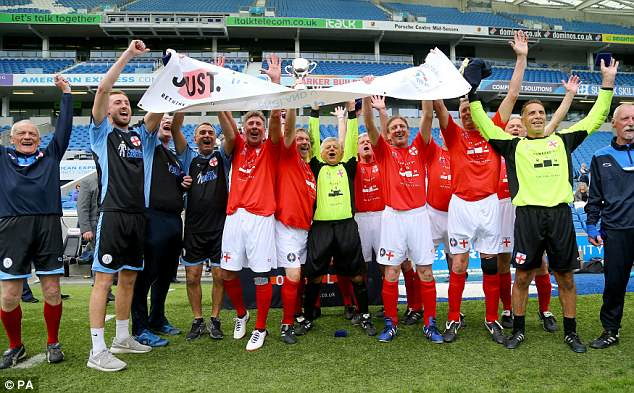 The England Over 60s celebrate their 3-0 victory in the Just International Cup against Italy