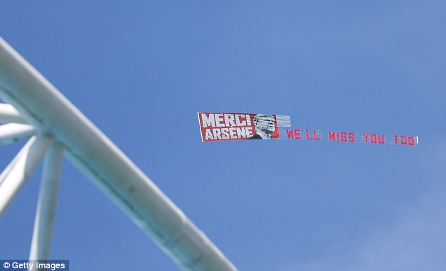 A plane even flew over the stadium with a banner reading: 'Merci Arsene, we'll miss you too'