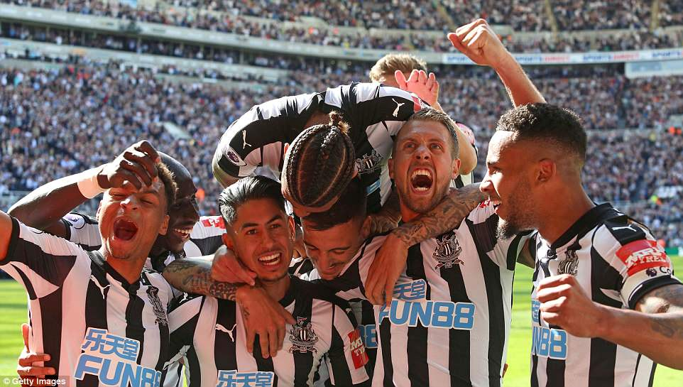 Newcastle players celebrate in front of their ecstatic fans at St James' Park after sealing an emphatic victory over Chelsea