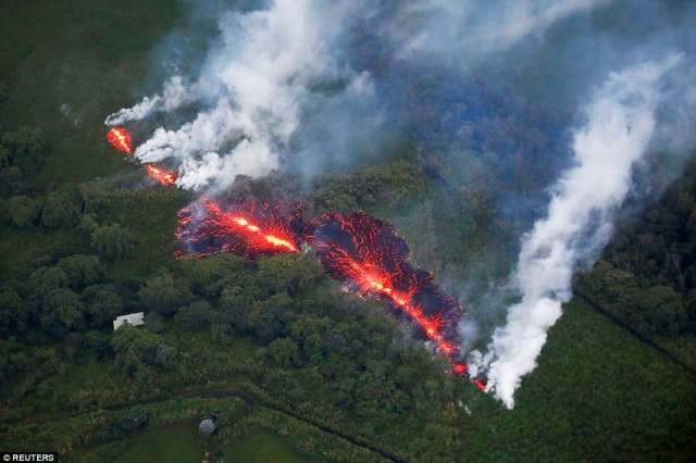 A massive new fissure opened on Hawaii's Kilauea volcano, hurling bursts of rock and magma with an ear-piercing screech on Sunday as it threatened nearby homes within a zone where authorities had just ordered an evacuation