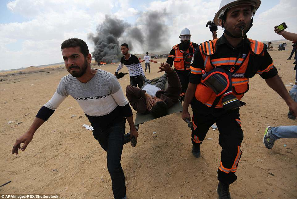 Medics were seen carrying Palestinian protesters away from the scene on stretchers as violence escalated this morning