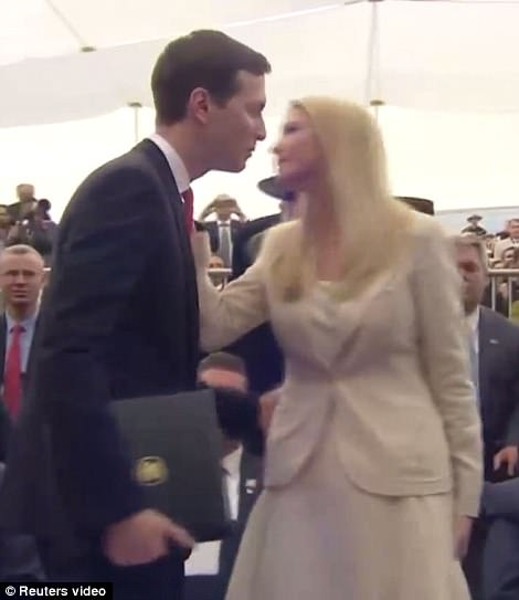 Jared Kushner embraces both his wife, Ivanka