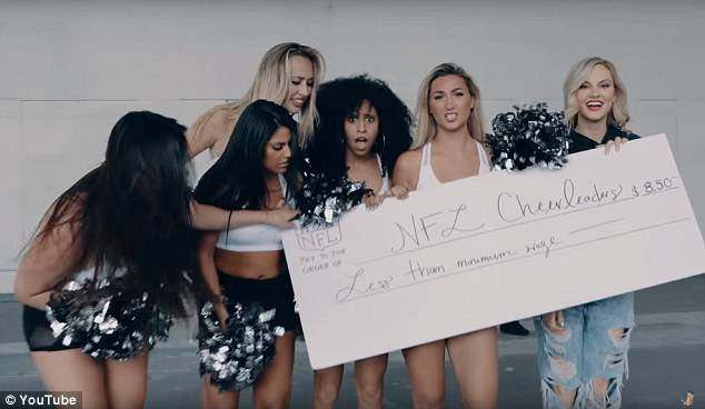 She addressed the gender wage gap, Arbour pictured right, handing over a minimum wage check to NFL cheerleaders