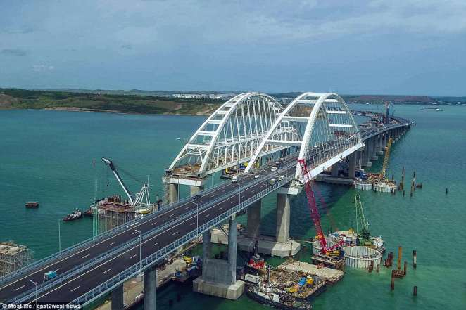 The bridge spans a treacherous strait between the Black and Azov seas, and gives a key link to the Russian mainland. But Ukraine has slammed its construction by the 'the Russian occupation forces'