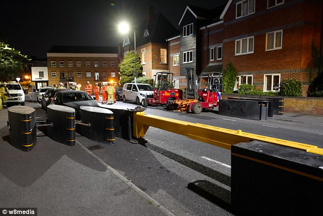 The huge yellow metal barricades was installed in the town centre overnight