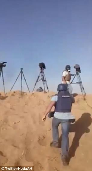 Footage shows the canisters dropping from a drone and thudding into the ground, sending reporters diving for cover and leaving them coughing and gasping for air