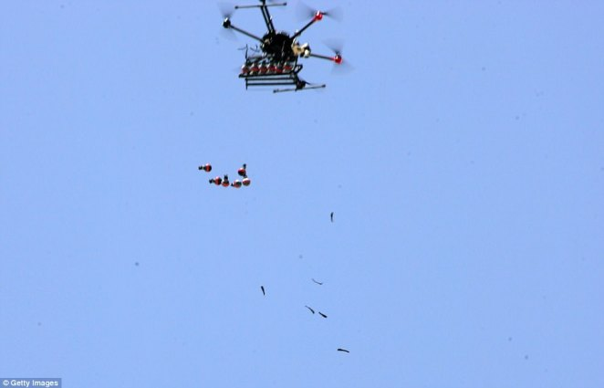A drone unleashes a series of tear gas canisters as Israeli forces attempt to clear protesters in Huzaa village of Khan Yunis
