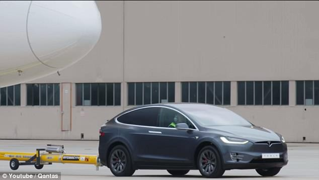 The Dreamliner is more than triple the Model X's (pictured) recommended tow limit of about 5,500 lbs, according to Australian airline Qantas, which supplied the Dreamliner
