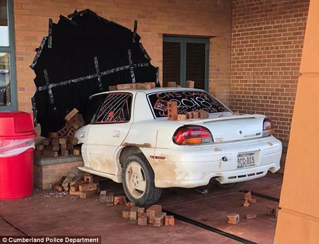 Four students at Cumberland High School in Wisconsin fooled people into thinking a car had crashed into the principal's office on Monday with their elaborate senior prank