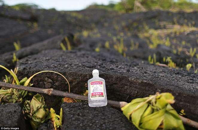Residents put out bottles of alcohol on Tuesday as offerings to the Pele, the Hawaiian Goddess of Fire