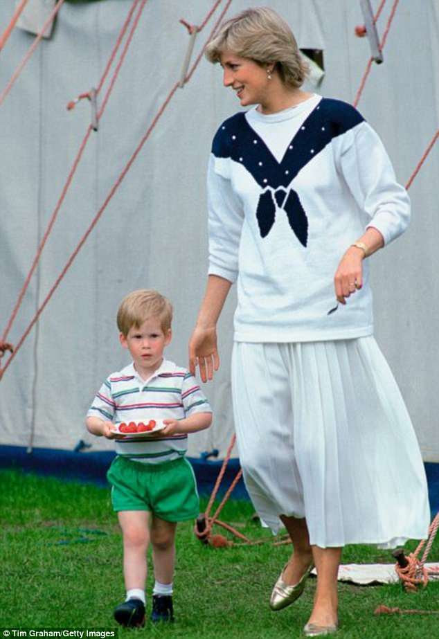 Diana, Princess of Wales with her second son Prince Harry carrying a plate of strawberries