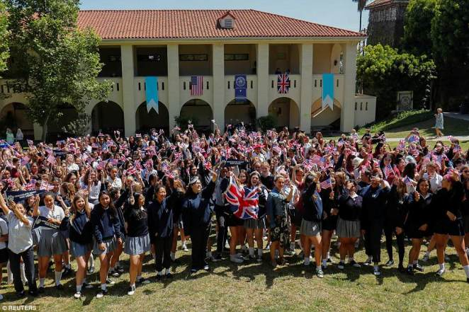 The school posed with a British flag for a group photo and even hung the Union Jack next to the American flag on its balcony