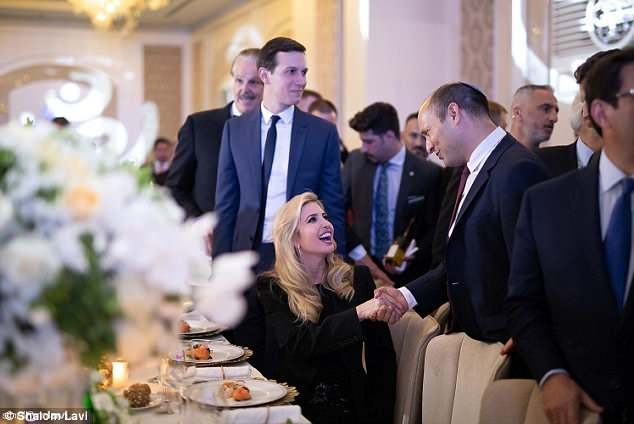 Kushner said on Monday that the United States showed the world it could be trusted by opening its Israeli embassy in Jerusalem. He is seen above looking on as wife Ivanka shakes hands with Naftali Bennett, Israel's minister of education