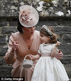 Kate with Princess Charlotte after Pippa Middleton's wedding in May last year