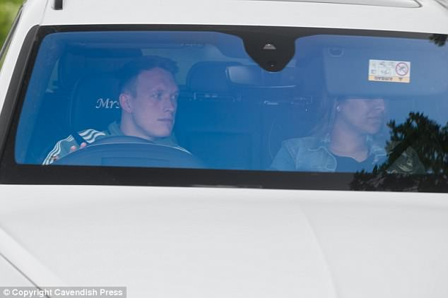 Phil Jones arrived at Manchester United training on Wednesday alongside wife Kaya Hall